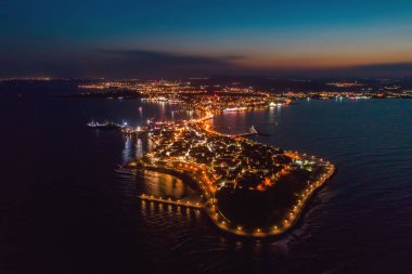 Night view of Nessebar, the ancient city on the Black Sea coast of Bulgaria. Panoramic aerial view. stock vector