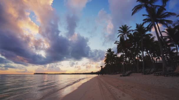 Girl running on tropical beach early in the morning. Sunrise over caribbean island Dominican Republic