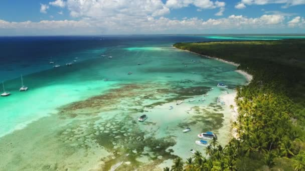 Beach, boats and tropical island between Caribbean sea and Atlantic ocean. Dominican Republic