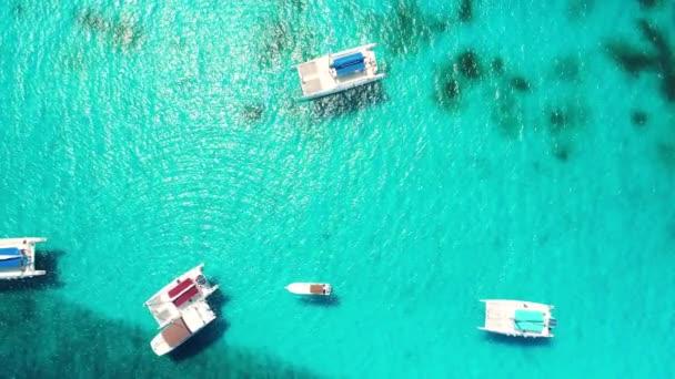 Caribbean sea, aerial view. Catamaran, sailboats and speed boats in the ocean.