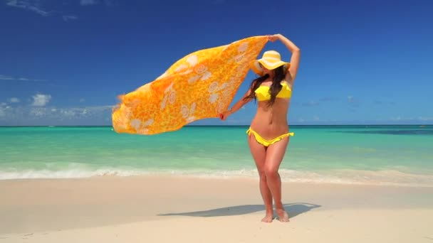 Carefree young woman relaxing on exotic beach. Caribbean tropical vacation. Dominican Republic