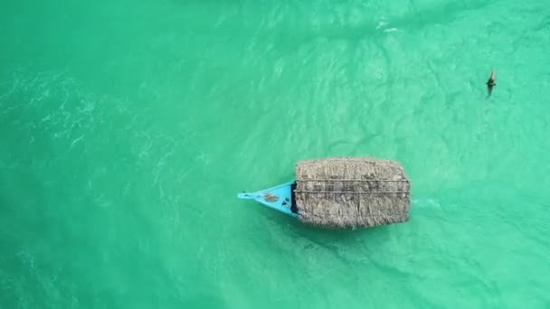 Tropical boat sailing on clear turquoise water of caribbean sea, aerial view