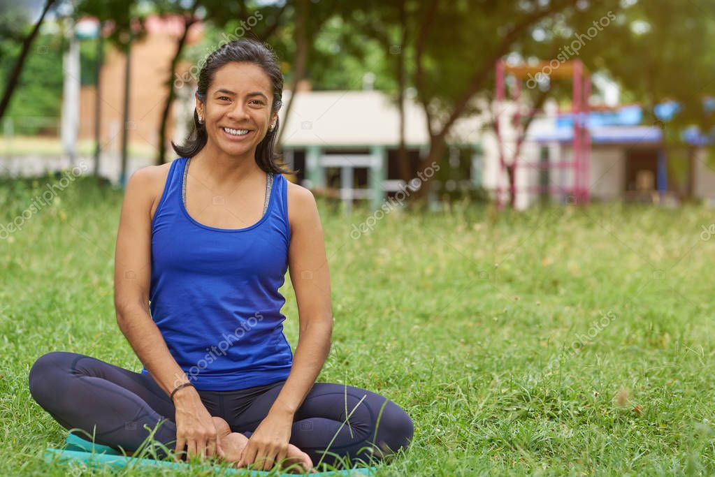 Happy smiling woman in yoga classes