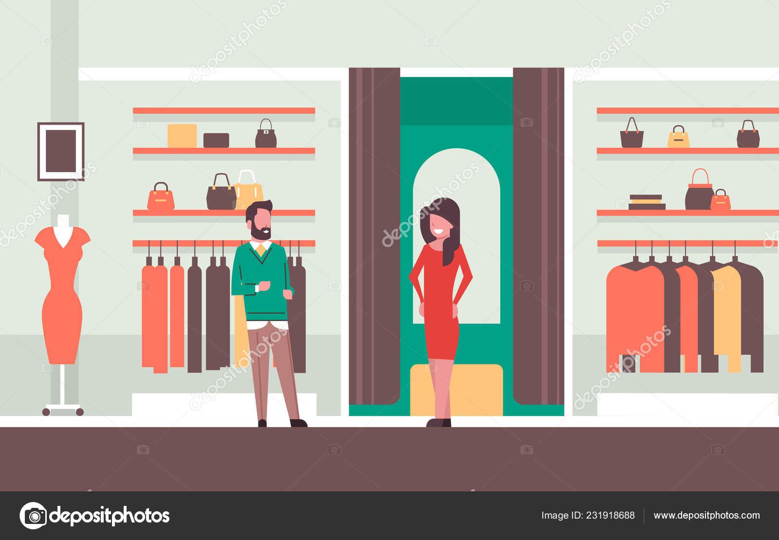 Consultor de vendedor homem perto mulher experimenta o novo vestido  elegante mulher olhando para o espelho da moda loja roupa feminina mercado  moderno ... 1eea2c32edf