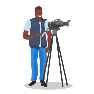 african american television operator using video camera on tripod happy cameraman looking through camcorder movie making concept flat full length