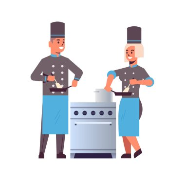 cooks couple professional chefs using frying pan stirring food man woman restaurant kitchen workers in uniform standing together near stove cooking concept flat full length