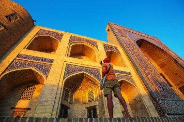 Tourist near ancient historic building in Uzbekistan