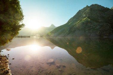 Beautiful serene lake in  Fanns mountains (branch of Pamir) in Tajikistan. stock vector