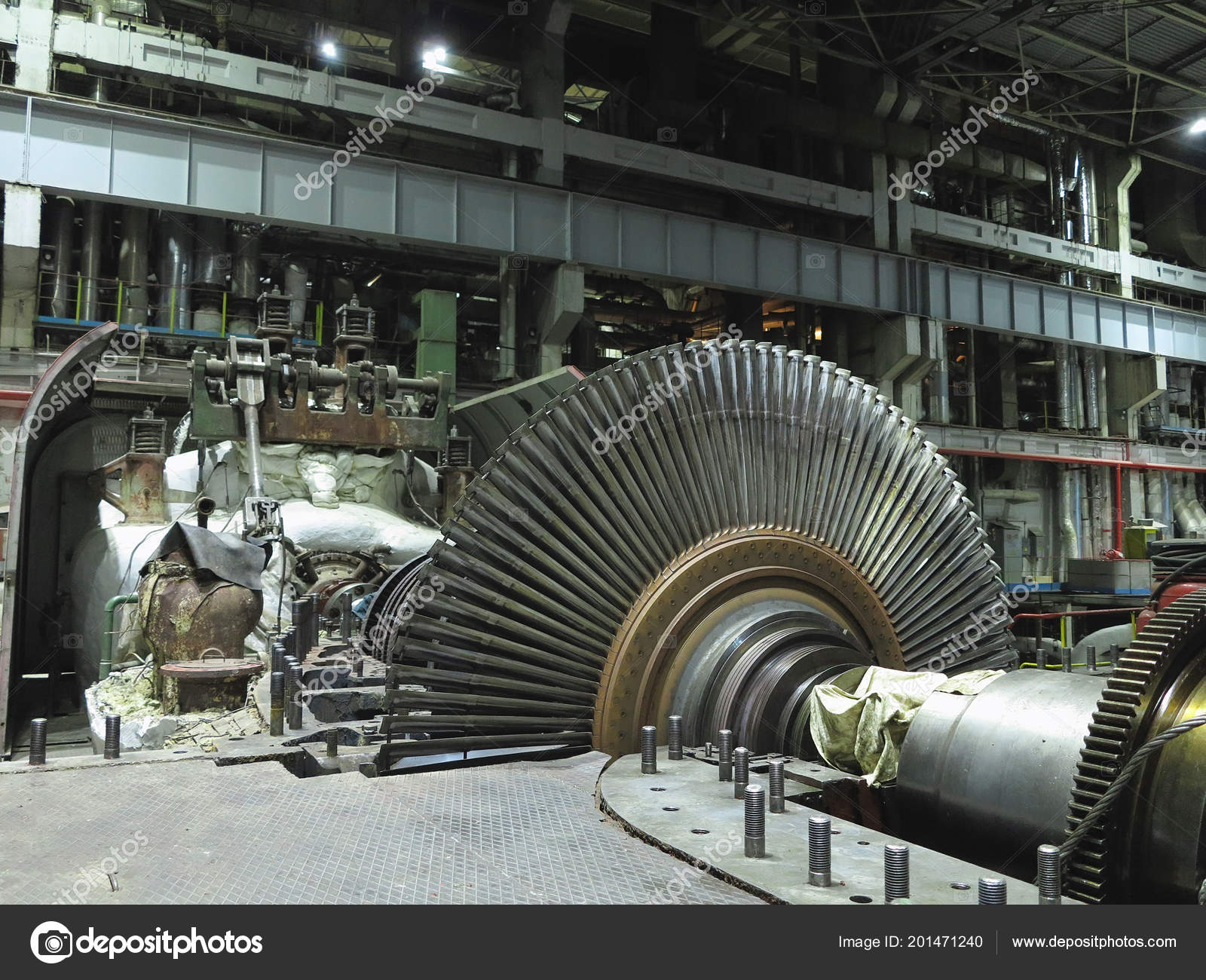 electric generator power plant early electric disassembled steam turbine in the process of repairing an electric generator at power plant photo by arogant steam turbine process repairing electric generator