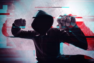 Violence and crime on the streets, digital glitch effect, victim is punched and mugged by aggressive violent man in hooded jacket, cctv security camera pov perspective