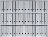 Fotografie Büroregal mit Ordnern in weißer Farbe für Archiv- und Datenorganisationskonzepte