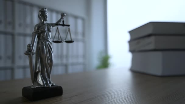 Lady Justice statue in dark empty law firm office, selective focus
