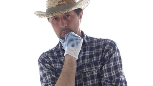 Portrait of thoughtful farmer in contemplative pose with hand on his chin. Footage of male agronomist is isolated on white background.