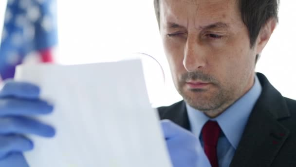 Businessman with magnifying glass doing business financial auditing, examination and evaluation of financial reports