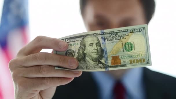 American businessman holding 100 dollar bill, close up of male business person hand