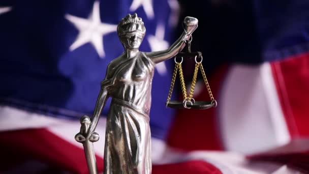 Law and Justice in United States of America, statue of Lady Justice with USA flag in background, selective focus