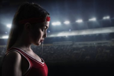 female boxer in red sportswear before the fight