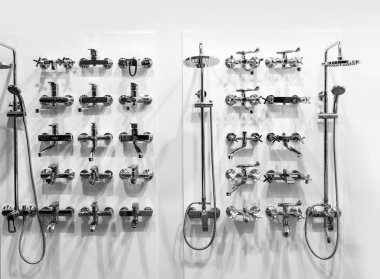 New chrome showers and faucets in plumbing shop, nobody. Sanitary equipment