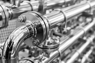 Steel water pipelines, metal fittings, closeup. Reliable plumbing engineering technology