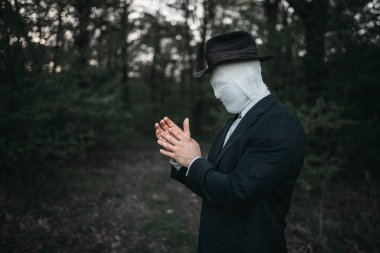 Serial maniac with face wrapped in bandages, bloody killer concept, crazy murderer, crime and violence horror