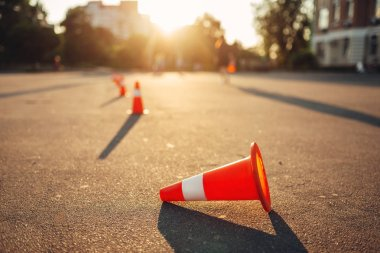 Fallen cone on training ground for the examination, driving school concept. lesson for novice car drivers, test for beginner