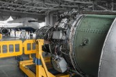 Photo Jet airplane turbine on repairing in hangar, plane engine without covers on maintenance, nobody. Air transportation safety concept