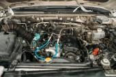 Fotografie Car with opened hood, closeup view on engine, automobile service, motor diagnostic. Vehicle heart maintenance, auto-service