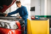 Photo Mechanic checks air conditioning system in car. Conditioner inspection, diagnostic