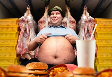 Happy fat man and fast food, pork carcasses on background. Overweight people, burgers eating