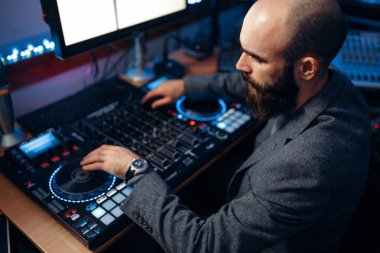 Male sound editor at remote control panel in the recording studio. Musician at the mixer, professional audio mixing stock vector