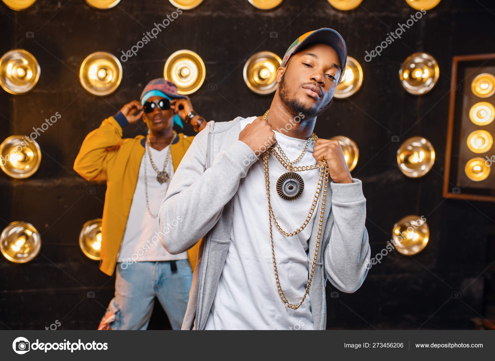 Two African Rappers Caps Artists Posing Stage Spotlights