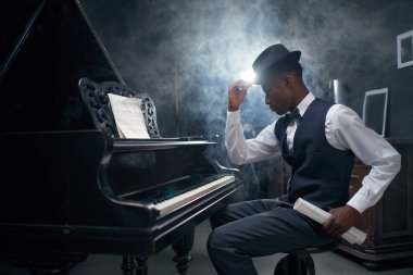 African grand piano player, jazz musician.