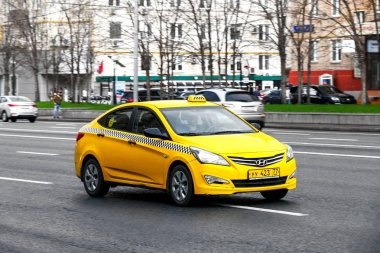 Moscow, Russia - May 2, 2018: Yellow taxi car Hyundai Solaris in the city street.