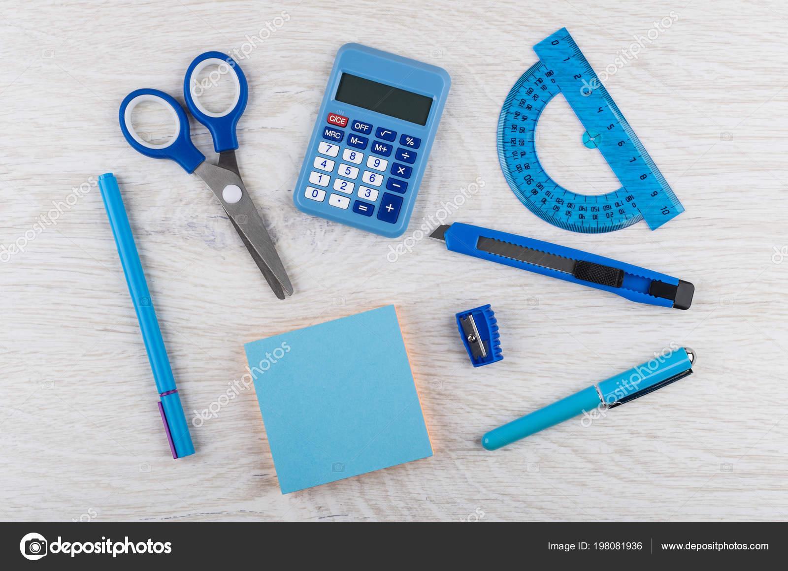 Organizer, notebook, pen, pencil, marker, cutter and calculator on.