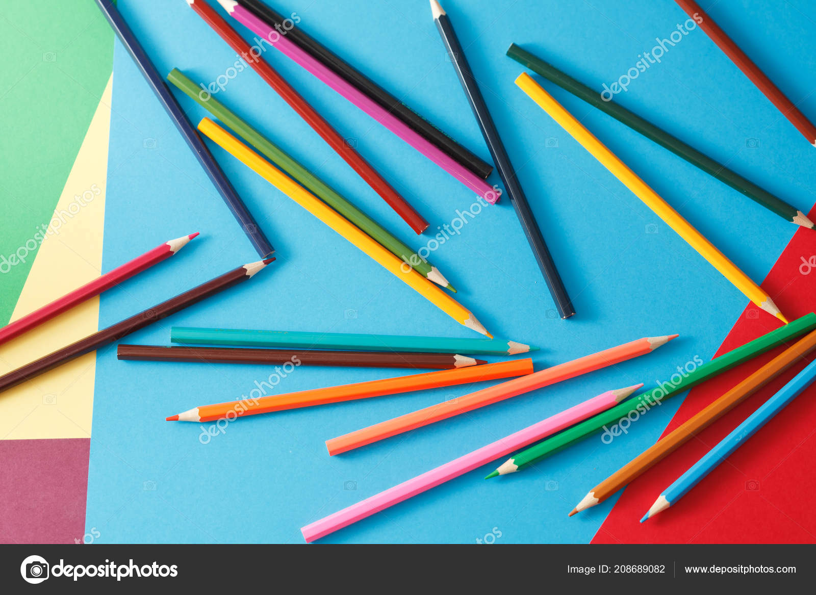 multicolored pencils colored paper stationery table stock photo