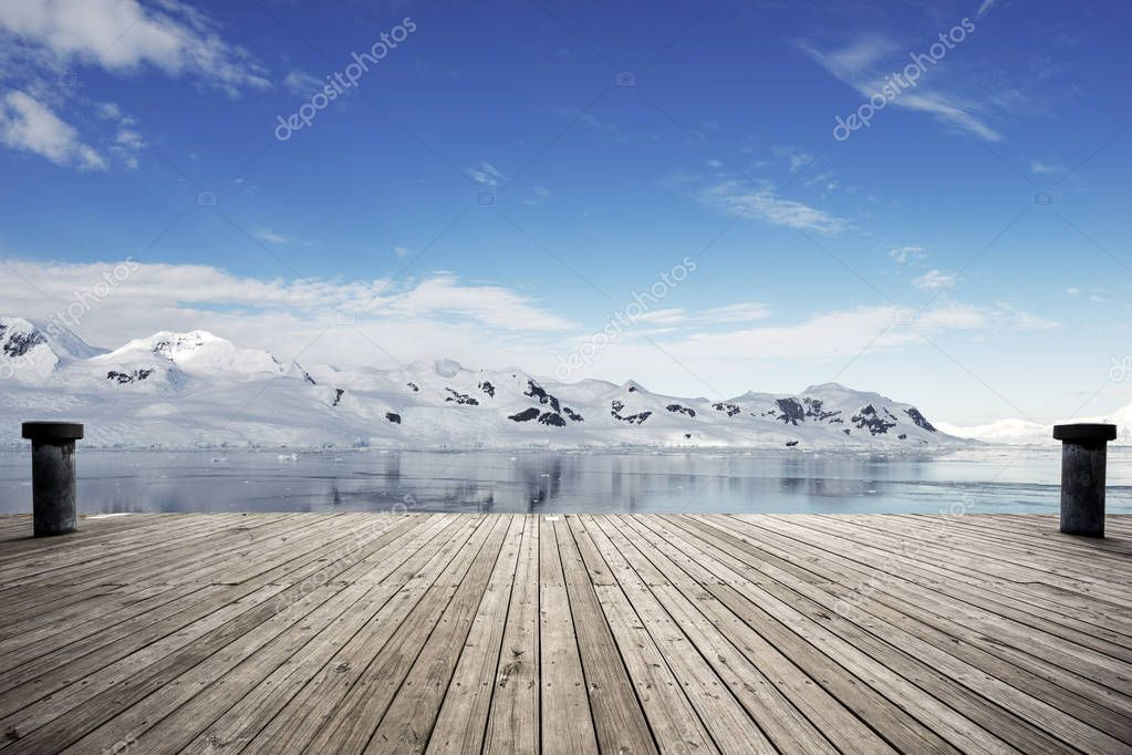 empty brick ground with snow mountains as background