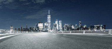 empty asphalt highway with modern cityscape New York