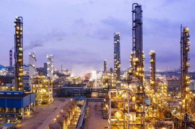 Oil and gas industrial. Oil refinery plant form industry at night.