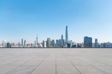 empty brick floor with modern metropolis cityscape in shanghai