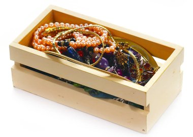wooden box with precious stones and gold products