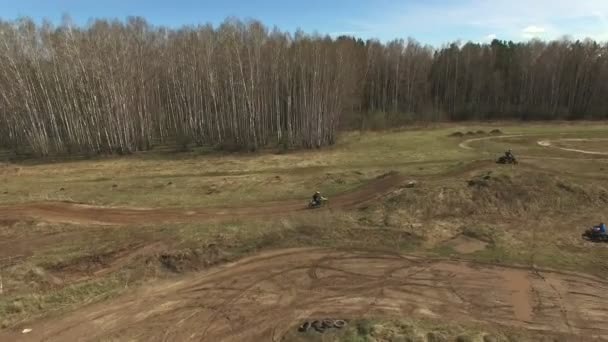 Aerial view of motocross motorcycle riders bikes cross-country.