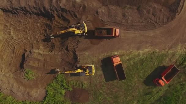 heavy machine excavators and trucks working on construction site. Aerial view.