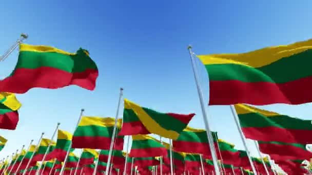 Many flags of Lithuania fluttering in the wind on flag poles against blue sky.  Three dimensional rendering animation.