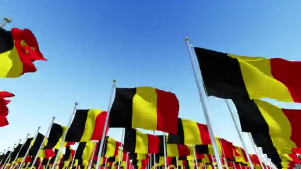 Many National Flags of Belgium against blue sky.  Three dimensional rendering 3D animation.