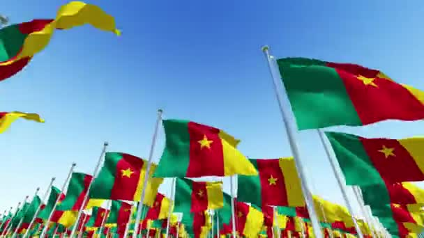Many National Flags of Cameroon against blue sky. Three dimensional rendering 3D animation.
