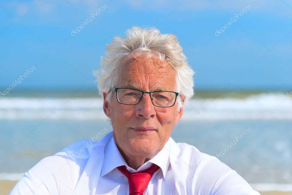 Portrait Business man in formal suit at the beach