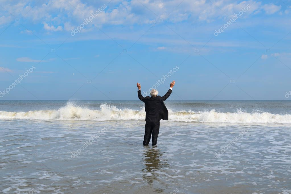 Business man walking in the sea