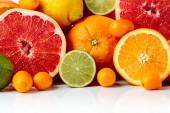 Fotografie Close up of citrus fruits. Pieces of lemon, lime , tangerine , pink grapefruit and orange.