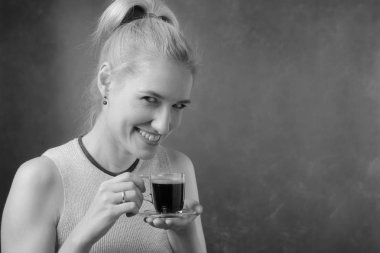 Portrait of a beautiful mid age woman with cup of coffee. Attractive and happy blonde drinks coffee. Copy space. Black and white. stock vector