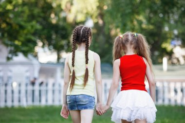 Two little girls in the park.